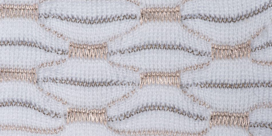The hang-up stitches on the back of the knitted sensor